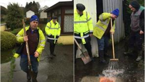 Flooding Minister Kevin 'Boxer' Moran rolls up his sleeves to assist flood stricken Longford family