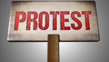Local employment service workers take to streets