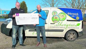 Sponsor Derek Sheridan of  Sherpack Ltd presenting a €5,000 donation to Brendan Considine for the Malin to Mizen Cycle