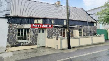 Into the West! Jesse James Tavern for sale with two bedrooms