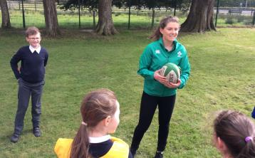 Irish rugby star Ellen Murphy pictured with some of the students