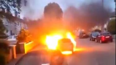 VIDEO: Firefighters rush to car in flames in housing estate